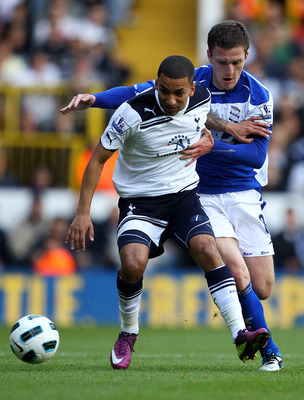 LONDON, ENGLAND - MAY 22: Aaron Lennon of Tottenham Hotspur is closed down by Craig Gardner of Birmingham City during the Barclays Premier League match between Tottenham Hotspur and Birmingham City at White Hart Lane on May 22, 2011 in London, England.  (
