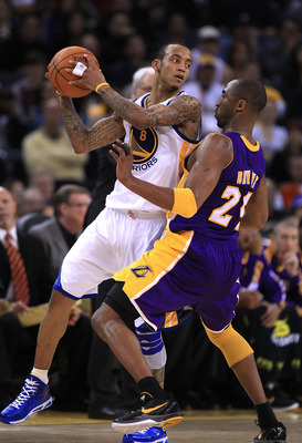 OAKLAND, CA - JANUARY 12: Kobe Bryant #24 of the Los Angeles Lakers plays tight defense on Monta Ellis #8 of the Golden State Warriors at Oracle Arena on January 12, 2011 in Oakland, California. NOTE TO USER: User expressly acknowledges and agrees that, b