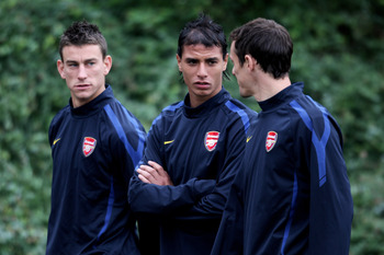 ST ALBANS, ENGLAND - SEPTEMBER 27:  (L-R)  Laurent Koscielny, Marouane Chamakh and Sebastien Squillaci speak prior to the training session ahead of the UEFA Champions League game against Partizan Belgrade at the club's complex at London Colney on Septembe