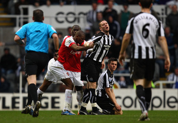 NEWCASTLE UPON TYNE, ENGLAND - FEBRUARY 05:  Abou Diaby of Arsenal pushes Kevin Nolan of Newcastle and gets sent off during the Barclays Premier League match between Newcastle United and Arsenal at St James' Park on February 5, 2011 in Newcastle upon Tyne