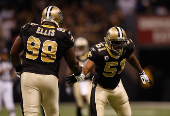 NEW ORLEANS - JANUARY 16:  Jonathan Vilma #51 and Sedrick Ellis #98 of the New Orleans Saints celebrate a defensive play against the Arizona Cardinals during the NFC Divisional Playoff Game at Louisana Superdome on January 16, 2010 in New Orleans, Louisia
