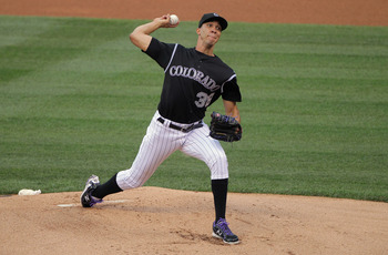 DENVER, CO - JULY 14:  Starting pitcher Ubaldo Jimenez #38 of the Colorado Rockies delviers against the Milwaukee Brewers at Coors Field on July 14, 2011 in Denver, Colorado. Jimenez earned the win as the Rockies defeated the Brewers 12-3.  (Photo by Doug
