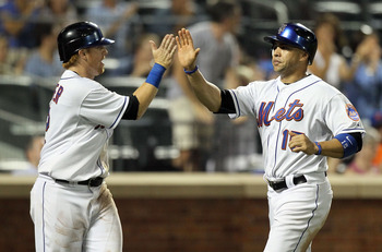 NEW YORK, NY - JULY 19:  Carlos Beltran #15 and Justin Turner #2 of the New York Mets celebrate after scoring in the sixth inning against the St. Louis Cardinals at Citi Field on July 19, 2011 in the Flushing neighborhood of the Queens borough of New York