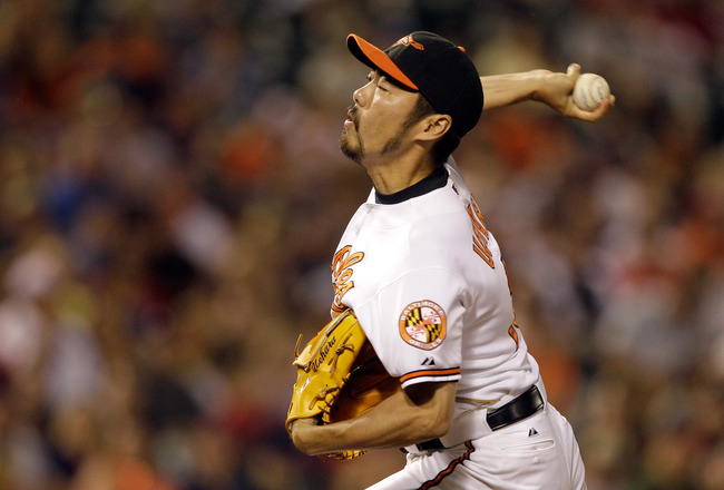 BALTIMORE, MD - JULY 16: Pitcher Koji Uehara #19 of the Baltimore Orioles delivers to a Cleveland Indians batter at Oriole Park at Camden Yards on July 16, 2011 in Baltimore, Maryland.  (Photo by Rob Carr/Getty Images)