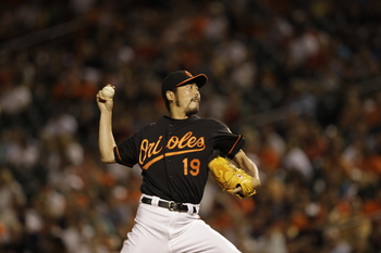 BALTIMORE, MD - JULY 15:  Closer Koji Uehara #19 of the Baltimore Orioles delivers to a Cleveland Indians batter during the  Orioles' 6-5 loss at Oriole Park at Camden Yards on July 15, 2011 in Baltimore, Maryland.  (Photo by Rob Carr/Getty Images)