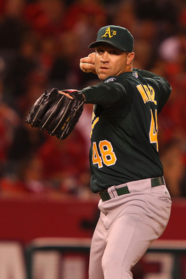 ANAHEIM, CA - MAY 23:  Michael Wuertz #48 of the Oakland Athletics pitches during the eighth inning during the game against the Los Angeles Angels of Anaheim at Angel on May 23, 2011 in Anaheim, California.  (Photo by Joe Scarnici/Getty Images)