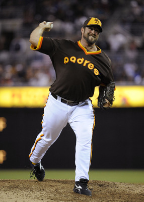 SAN DIEGO, CA - JULY 14: Heath Bell #21 of the San Diego Padres pitches during the ninth inning of baseball game against the San Francisco Giants at Petco Park on July 14, 2011 in San Diego, California. The Giants won 6-2.   (Photo by Denis Poroy/Getty Im
