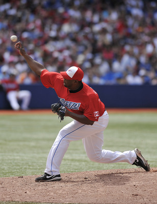 TORONTO, CANADA - JULY 1:  Frank Francisco #50 of the Toronto Blue Jays delivers a pitch during MLB interleague game action against Philadelphia Phillies July 1, 2011 at Rogers Centre in Toronto, Ontario, Canada. (Photo by Brad White/Getty Images)