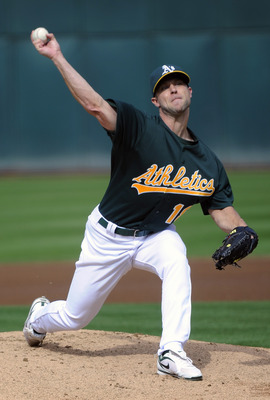 OAKLAND, CA - JULY 16: Rich Harden #18 of the Oakland Athletics pitches against the Los Angeles Angels of Anaheim in the first inning of game two of a double header at the O.co Coliseum July 16, 2011 in Oakland, California. (Photo by Thearon W. Henderson/