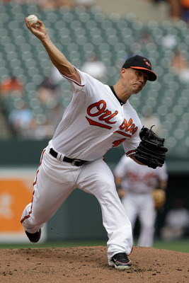BALTIMORE, MD - JULY 24:  Starting pitcher Jeremy Guthrie #46 of the Baltimore Orioles delivers to a Los Angeles Angels of Anaheim batter during the first inning at Oriole Park at Camden Yards on July 24, 2011 in Baltimore, Maryland.  (Photo by Rob Carr/G