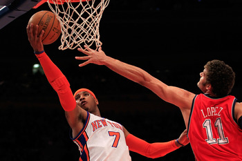 NEW YORK, NY - MARCH 30:  Carmelo Anthony #7 of the New York Knicks shoots over Brook Lopez #11 of the New Jersey Nets at Madison Square Garden on March 30, 2011 in New York City. NOTE TO USER: User expressly acknowledges and agrees that, by downloading a
