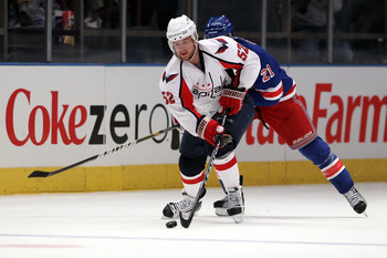 NEW YORK, NY - APRIL 17:  Mike Green #52 of the Washington Capitals skates with the puck against the New York Rangers in Game Three of the Eastern Conference Quarterfinals during the 2011 NHL Stanley Cup Playoffs at Madison Square Garden on April 17, 2011