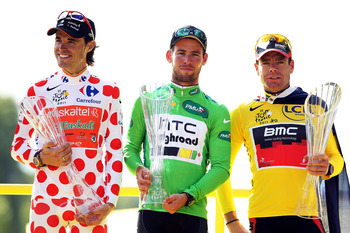 PARIS, FRANCE - JULY 24:  (L-R) Samuel Sanchez of team Euskatel, winner of the polka dot king of the mountains competition, Mark Cavendish of team HTC, winner of the points jersey and Cadel Evans of team BMC and winner of the yellow jersey celebrate on th