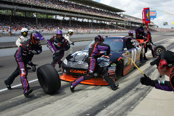 INDIANAPOLIS - JULY 25:  Denny Hamlin, driver of the #11 FedEx Office Toyota, pits during the NASCAR Sprint Cup Series Brickyard 400 at Indianapolis Motor Speedway on July 25, 2010 in Indianapolis, Indiana.  (Photo by Jerry Markland/Getty Images for NASCA