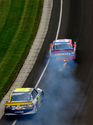 INDIANAPOLIS - JULY 25:  Max Papis, driver of the #13 GEICO Toyota, blows an engine during the NASCAR Sprint Cup Series Brickyard 400 at Indianapolis Motor Speedway on July 25, 2010 in Indianapolis, Indiana.  (Photo by Rusty Jarrett/Getty Images for NASCA