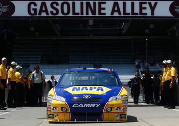 INDIANAPOLIS - JULY 23:  Martin Truex Jr., driver of the #56 NAPA Toyota, drives to the garage during practice for the NASCAR Sprint Cup Series Brickyard 400 at Indianapolis Motor Speedway on July 23, 2010 in Indianapolis, Indiana.  (Photo by Jason Smith/