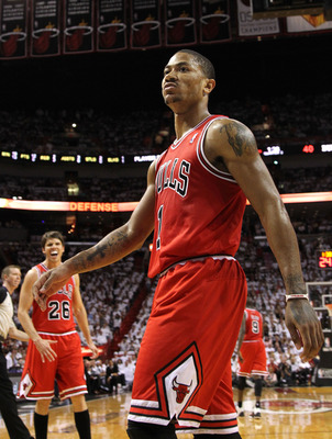 MIAMI, FL - MAY 24:  Derrick Rose #1 of the Chicago Bulls reacts after he dunked on Joel Anthony #50 of the Miami Heat in the first half of Game Four of the Eastern Conference Finals during the 2011 NBA Playoffs on May 24, 2011 at American Airlines Arena