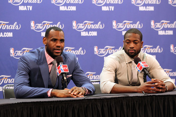 MIAMI, FL - JUNE 12:  (L-R) LeBron James #6 and Dwyane Wade #3 of the Miami Heat answers questions from the media at a post game news conference after the Dallas Mavericks won 105-95 in Game Six of the 2011 NBA Finals at American Airlines Arena on June 12
