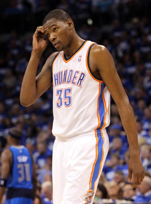 OKLAHOMA CITY, OK - MAY 21:  Kevin Durant #35 of the Oklahoma City Thunder looks on in the first half while taking on the Dallas Mavericks in Game Three of the Western Conference Finals during the 2011 NBA Playoffs at Oklahoma City Arena on May 21, 2011 i