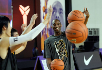 SEOUL, SOUTH KOREA - JULY 14:  NBA player Kobe Bryant #24 of the Los Angeles Lakers participates in an teaching session for South Korean fans during a promotional tour of South Korea at the Korea University on July 14, 2011 in Seoul, South Korea.  (Photo