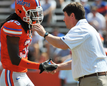GAINESVILLE, FL - APRIL 9:  Coach Will Muschamp of the Florida Gators congratulates cornerback Moses Jenkins #36 during the Orange and Blue spring football game April 9, 2011 at Ben Hill Griffin Stadium in Gainesville, Florida.  (Photo by Al Messerschmidt