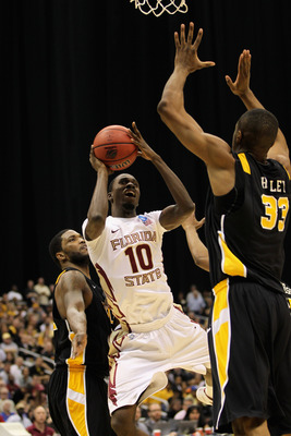 SAN ANTONIO, TX - MARCH 25:  Okaro White #10 of the Florida State Seminoles puts up a shot against D.J. Haley #33 of the Virginia Commonwealth Rams during the southwest regional of the 2011 NCAA men's basketball tournament at the Alamodome on March 25, 20