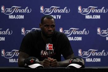 MIAMI, FL - JUNE 11:  LeBron James #6 of the Miami Heat answers questions from the media during practice prior to Game 6 of the 2011 NBA Finals against the Dallas Mavericks at the American Airlines Arena on June 11, 2011 in miami, Florida. Game 6 will be