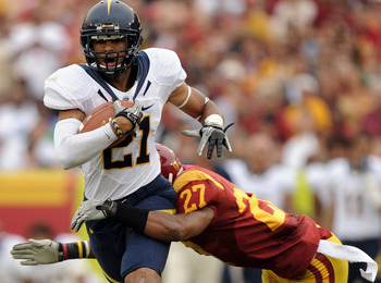 LOS ANGELES, CA - OCTOBER 16:  Keenan Allen #21 of the California Golden Bears is tackled by Marshall Jones #27 of the USC Trojans during the second quarter at Los Angeles Memorial Coliseum on October 16, 2010 in Los Angeles, California.  (Photo by Harry