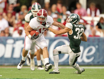 ORLANDO, FL - JANUARY 01:  Brad Smelley #17 of the Alabama Crimson Tide runs after a catch stiffarming Mitchell White #32 of the Michigan State Spartans during the Capitol One Bowl at the Florida Citrus Bowl on January 1, 2011 in Orlando, Florida.  (Photo
