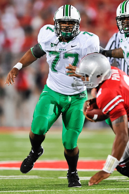 COLUMBUS, OH - SEPTEMBER 2: DeMetrius Thompson #77 of the Marshall Thundering Herd pursues the ballcarrier against the Ohio State Buckeyes at Ohio Stadium on September 2, 2010 in Columbus, Ohio. (Photo by Jamie Sabau/Getty Images)