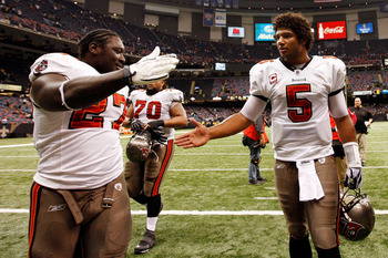 NEW ORLEANS, LA - JANUARY 02:  Quarterback Josh Freeman #5  celebrates with LeGarrette Blount #27 of the Tampa Bay Buccaneers after defeating the New Orleans Saints 23-13 at the Louisiana Superdome on January 2, 2011 in New Orleans, Louisiana.   (Photo by