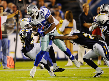 SAN DIEGO - AUGUST 21: Running back Lonyae Miller #35 the Dallas Cowboys escapes from tackles during the pre-season NFL football game against San Diego Chargers at Qualcomm Stadium on August 21, 2010 in San Diego, California.  (Photo by Kevork Djansezian/