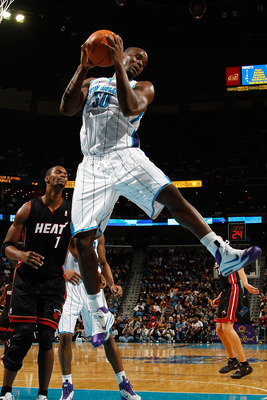 NEW ORLEANS - NOVEMBER 05:  Emeka Okafor #50 of the New Orleans Hornets grabs a rebound during the game against the Miami Heat at the New Orleans Arena on November 5, 2010 in New Orleans, Louisiana.  NOTE TO USER: User expressly acknowledges and agrees th