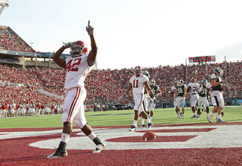 ORLANDO, FL - JANUARY 01:  Eddie Lacy #42 of the Alabama Crimson Tide celebrates after rushing for a touchdown during the Capitol One Bowl against the Michigan State Spartans at the Florida Citrus Bowl on January 1, 2011 in Orlando, Florida.  (Photo by Mi