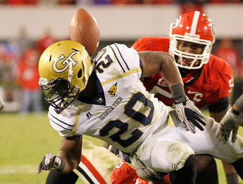ATHENS, GA - NOVEMBER 27:  Roddy Jones #20 of the Georgia Tech Yellow Jackets has the ball stripped behind him by the Georgia Bulldogs at Sanford Stadium on November 27, 2010 in Athens, Georgia.  (Photo by Kevin C. Cox/Getty Images)