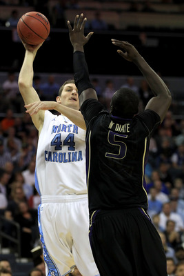 CHARLOTTE, NC - MARCH 20:  Tyler Zeller #44 of the North Carolina Tar Heels shoots over Aziz N'Diaye #5 of the Washington Huskies in the first half during the third round of the 2011 NCAA men's basketball tournament at Time Warner Cable Arena on March 20,