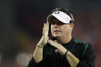 GLENDALE, AZ - JANUARY 10:  Head coach Chip Kelly of the Oregon Ducks calls a time out during their 22-19 loss to the Auburn Tigers during the Tostitos BCS National Championship Game at University of Phoenix Stadium on January 10, 2011 in Glendale, Arizon
