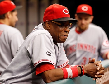 ST. PETERSBURG, FL - JUNE 29:  Manager Dusty Baker #12 of the Cincinnati Reds directs his team against the Tampa Bay Rays during the game at Tropicana Field on June 29, 2011 in St. Petersburg, Florida.  (Photo by J. Meric/Getty Images)