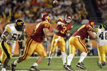 MIAMI - JANUARY 2:  Quarterback Carson Palmer #3 of USC throws to Alex Holmes #81 against Iowa during the FedEx Orange Bowl at Pro Player Stadium on January 2, 2003 in Miami, Florida.  The University of Southern California Trojans defeated the Iowa Hawkey