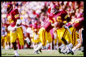 Sep 1986:  Quarterback Rodney Peete of the USC Trojans rolls out of the pocket during a game against the Illinois Fighting Illini at the Los Angeles Memorial Coliseum in Los Angeles, California.  Mandatory Credit: Mike Powell  /Allsport