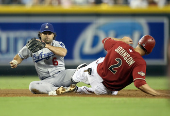PHOENIX, AZ - JULY 17:  Infielder Aaron Miles #6 of the Los Angeles Dodgers gets the force out on Kelly Johnson #2 of the Arizona Diamondbacks at second base during the first inning of the Major League Baseball game at Chase Field on July 17, 2011 in Phoe