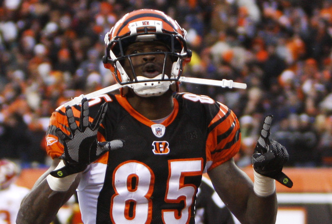 CINCINNATI - DECEMBER 27: Chad Ochocinco  #85 of the Cincinnati Bengals celebrates his touchdown catch by holding up the number 15 in memory of Chris Henry against the Kansas City Chiefs in their NFL game at Paul Brown Stadium December 27, 2009 in Cincinn