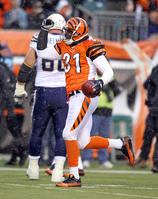 CINCINNATI - DECEMBER 26:  Roy Williams #31 of the Cincinnati Bengals celebrates after recovering a fumble during the NFL game against the San Diego Chargers at Paul Brown Stadium on December 26, 2010 in Cincinnati, Ohio. The Bengals 34-20.  (Photo by And