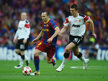 LONDON, ENGLAND - MAY 28:  Andres Iniesta of FC Barcelona (L) in action against Michael Carrick of Manchester United during the UEFA Champions League final between FC Barcelona and Manchester United FC at Wembley Stadium on May 28, 2011 in London, England