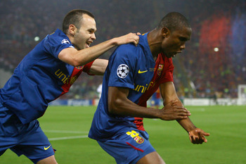 ROME - MAY 27:  Samuel Eto'o of Barcelona and his team mate Andres Iniesta celebrate after Eto'o scored the first goal for Barcelona during the UEFA Champions League Final match between Manchester United and Barcelona at the Stadio Olimpico on May 27, 200