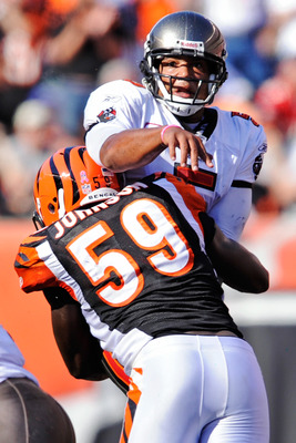 CINCINNATI, OH - OCTOBER 10:  Quarterback Josh Freeman #5 of the Tampa Bay Buccaneers is hit by Brandon Johnson #59 of the Cincinnati Bengals just as he releases the ball at Paul Brown Stadium on October 10, 2010 in Cincinnati, Ohio.  (Photo by Jamie Saba