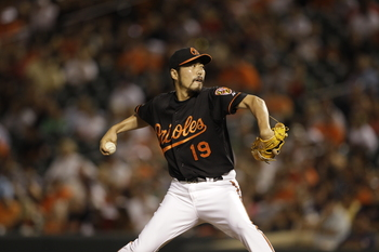 BALTIMORE, MD - JULY 15: Closer Koji Uehara #19 of the Baltimore Orioles delivers to a Cleveland Indians batter during the ninth inning of the Orioles 6-5 loss at Oriole Park at Camden Yards on July 15, 2011 in Baltimore, Maryland.  (Photo by Rob Carr/Get