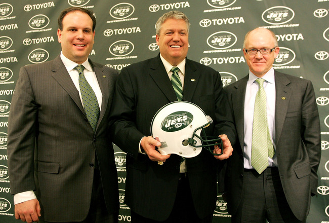 FLORHAM PARK, NJ - JANUARY 21: New York Jets Head Coach Rex Ryan (C) Owner Woody Johnson (R) and General Manager Mike Tannenbaum pose for a photo at a press conference naming Ryan as the new Head Coach of the New York Jets at the Atlantic Health Jets Trai