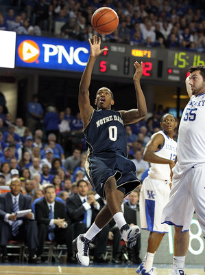LOUISVILLE, KY - DECEMBER 08:  Eric Atkins #0 of the Notre Dame Fighting Irish shoots the ball during the game against the Kentucky Wildcats in the 2010 DIRECTV SEC/BIG EAST Invitational at Freedom Hall on December 8, 2010 in Louisville, Kentucky.  (Photo