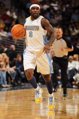 DENVER - NOVEMBER 16:  Ty Lawson #3 of the Denver Nuggets dribbles the ball against the New York Knicks at the Pepsi Center on November 16, 2010 in Denver, Colorado. The Nuggets defeated the Knicks 120-118. NOTE TO USER: User expressly acknowledges and ag